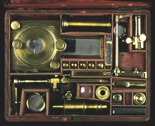 A microscope compendium, with all parts disassembled and packed away in a case.