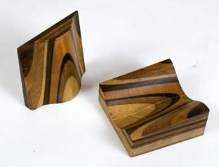 A carved geological model showing layers of wood.