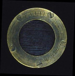 Micrometer with a fine silver-wire lattice