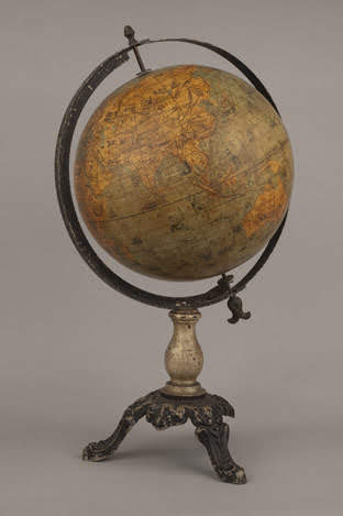 Table globe showing native flora and fauna in different geographical regions