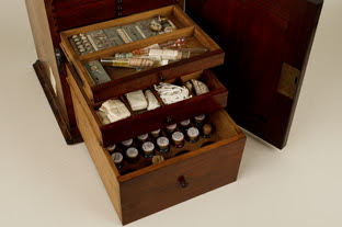 Wooden cabinet containing various slide-making materials used by Elcock.