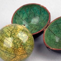 Detail of Darton's pocket globe with celestial cartography on the concave surface of its spherical case.