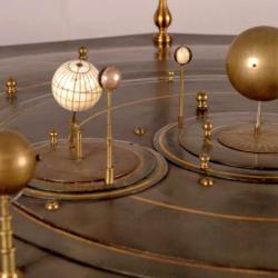 Detail from the grand orrery showing several planets and their satellites