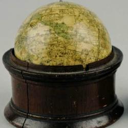 Pocket globe by London globemaker Newton, in a wooden case.
