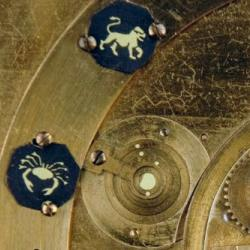 Detail from the face of the projecting planetarium showing part of the mechanism and some of the planets