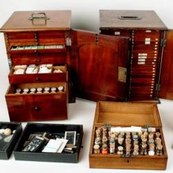 Elcock's archive of microscope slides and preparatory materials, displayed in portable wooden cases