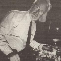 Francis Hookham portrait with calculator collection, 1988