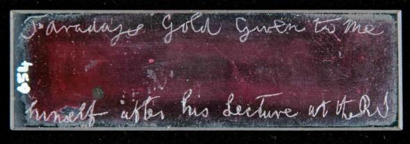 """Faraday's slide, bearing the inscription """"Faraday's gold given to me himself after his lecture at the RI""""."""