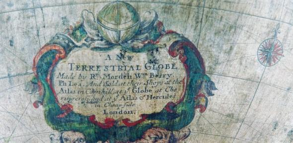"Detail of globe showing inscription ""A New TERRESTRIAL GLOBE, Made by Rt Morden, Wan Berry, Ph Lea. And Sold at their Shops at the Atlas in Cornhill, at ye Globe at Chering Cross, and at ye Atlas of Hercules in Cheapside, London."